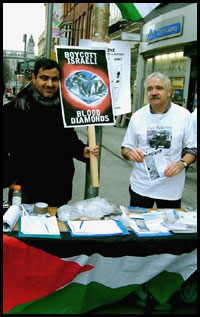 IPSC activists at a stall