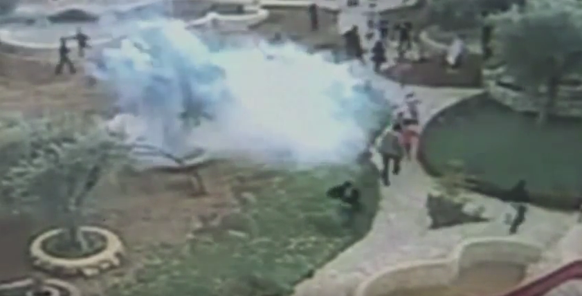 Israeli occuaption forces fire tear gas into a playground full of children in Aida