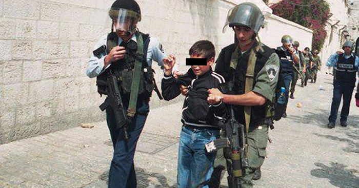 A child is arrested and detained by Israeli occupation forces in Aida camp